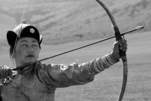 ULAN BATOR, MONGOLIA - JUNE 18: A Mongolian woman shows her archery skills on June 18, 2006 in Ulan Bator, Mongolia. Mongolia celebrates its 800th birthday this year. (Photo by Koichi Kamoshida/Getty Images)